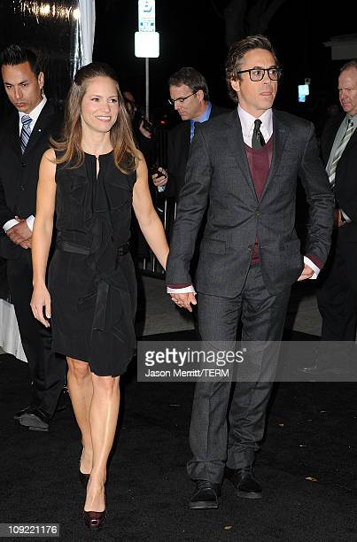 Executive Producer Susan Downey and actor Robert Downey Jr arrive at the Los Angeles premiere of Unknown at the Mann Village Theater on February 16...