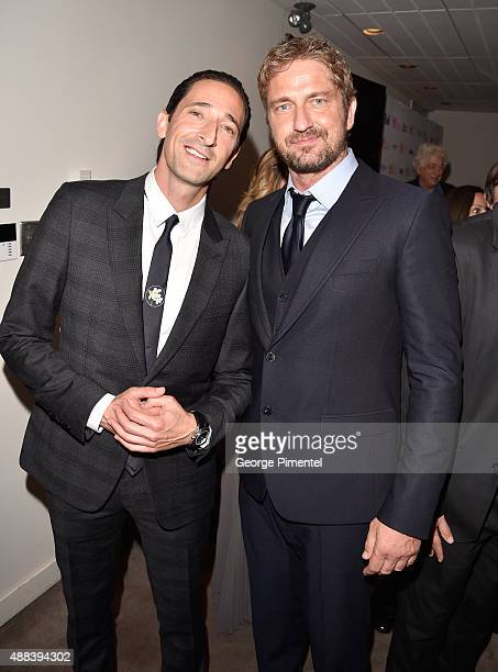 Executive producer/actor Adrien Brody and producer/actor Gerard Butler attends the 'Septembers of Shiraz' premiere during the 2015 Toronto...