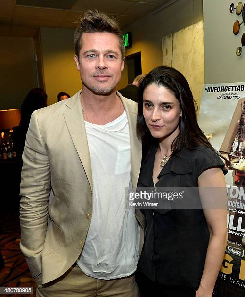 Executive producer/actor Brad Pitt and producer/director Rachel Boynton pose at the after party for a special screening of the documentary Big Men on...