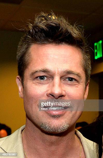 Executive producer/actor Brad Pitt poses at the after party for a special screening of the documentary 'Big Men' on March 26 2014 at the Sundance...