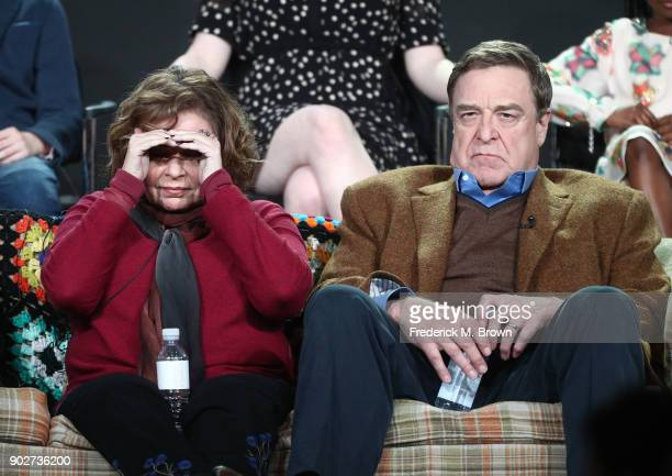 Executive producer/actress Roseanne Barr and actor John Goodman of the television show Roseanne look to the audience from the stage during the ABC...