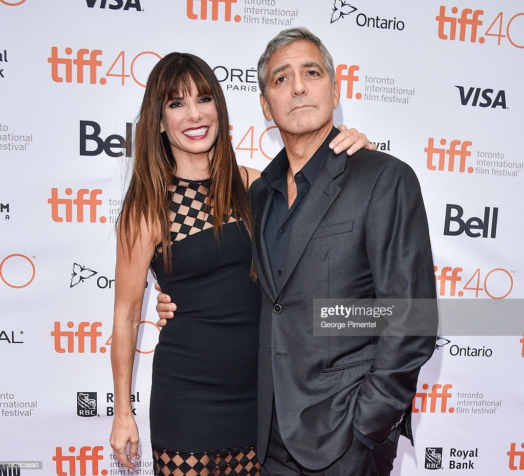 Executive Producer/Actress Sandra Bullock (L) and Producer George Clooney attend the 'Our Brand is Crisis' premiere during the 2015 Toronto International Film Festival at Princess of Wales Theatre on September 11, 2015 in Toronto, Canada.