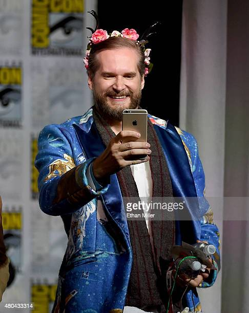 Executive producer/creator Bryan Fuller takes a photo onstage at the 'Hannibal' Savor the Hunt panel during ComicCon International 2015 at the San...