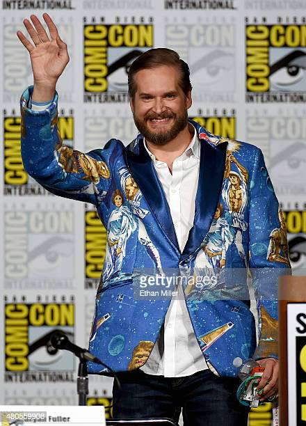 Executive producer/creator Bryan Fuller waves as he arrives at the 'Hannibal' Savor the Hunt panel during ComicCon International 2015 at the San...