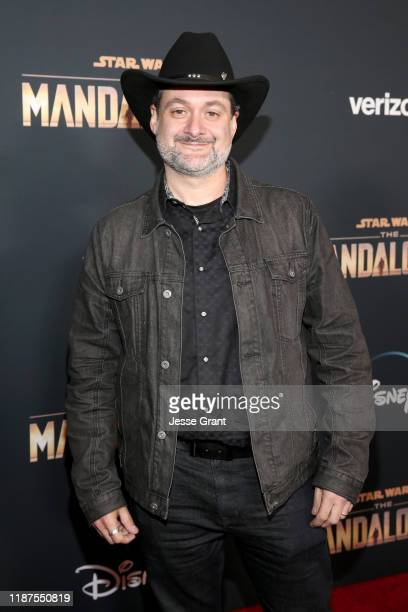 """Executive producer/director Dave Filoni arrives at the premiere of Lucasfilm's first-ever, live-action series, """"The Mandalorian,"""" at the El Capitan..."""