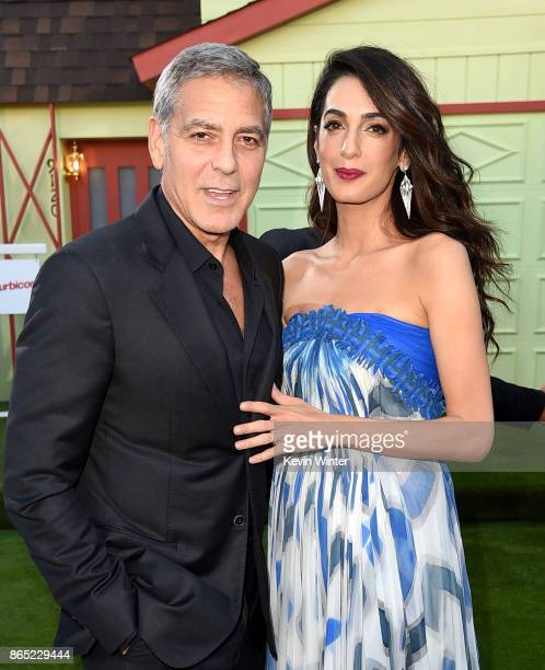 Executive producer/director George Clooney and his wife Amal Clooney arrive at the premiere of Paramount Pictures' Suburbicon at the Village Theatre...