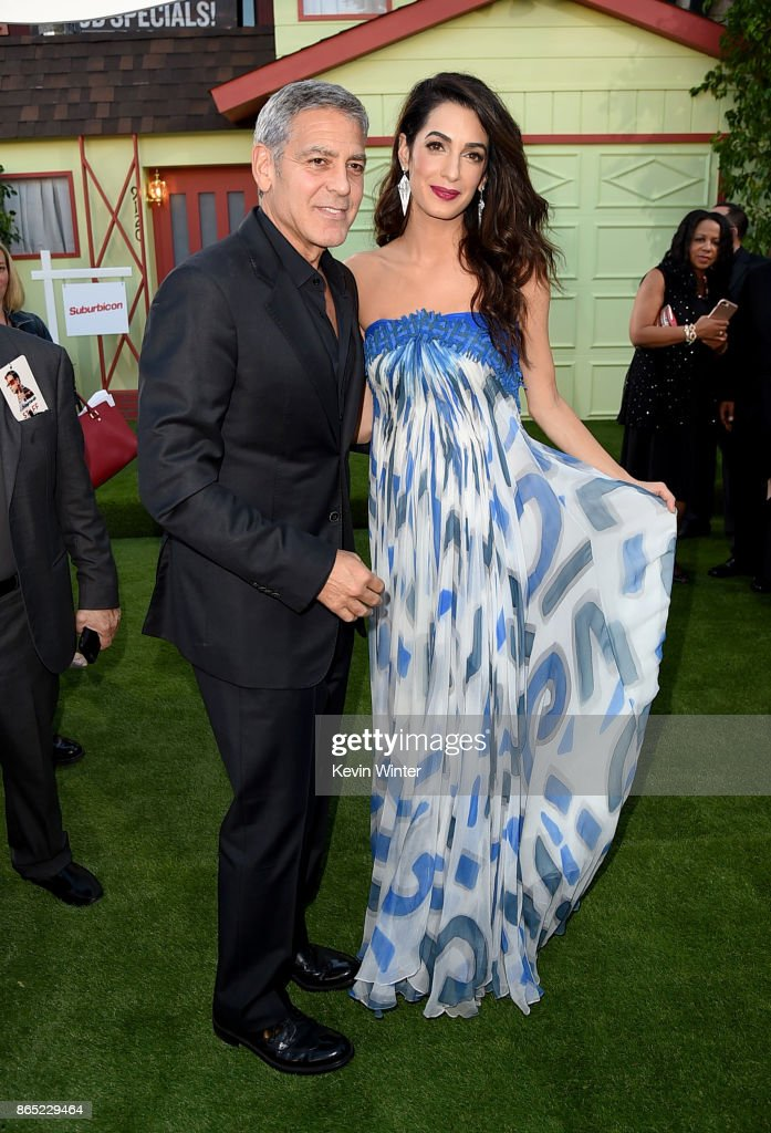 Executive producer/director George Clooney and his wife Amal Clooney