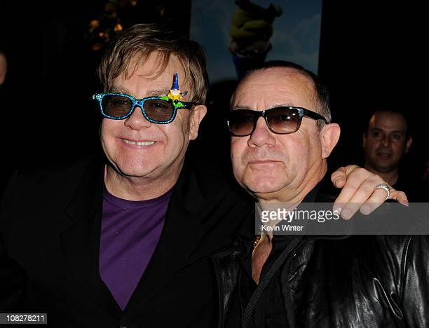 Executive producer/musician Elton John and songwriter Bernie Taupin pose at the after party for the premiere of Touchstone Pictures' Gnomeo and...