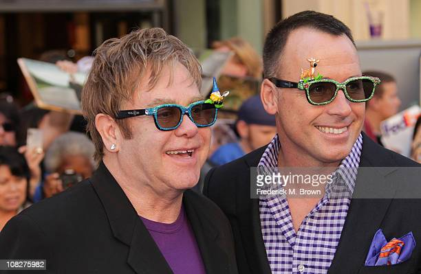 Executive producer/musician Sir Elton John and producer David Furnish attend the premiere of Touchstone Pictures' 'Gnomeo and Juliet' at the El...
