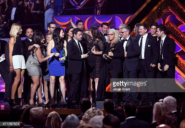 Executive producers Andy Lassner Mary Connelly Ed Glavin and crew members accept the award for Outstanding Talk Show Entertainment award for The...