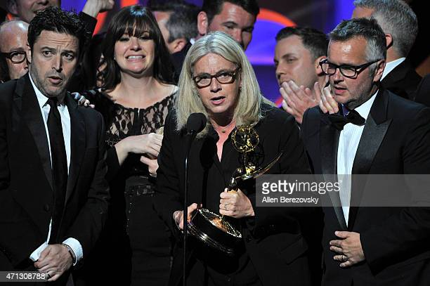 Executive producers Andy Lassner Mary Connelly Ed Glavin and crew members accept the award for Outstanding Talk Show Entertainment award for 'The...