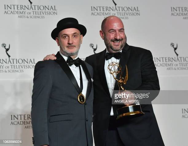 Executive Producers Fernando Gaston and Alejandro Rincon pose for a photo with the NonEnglish Language US Primetime Program award during the 46th...