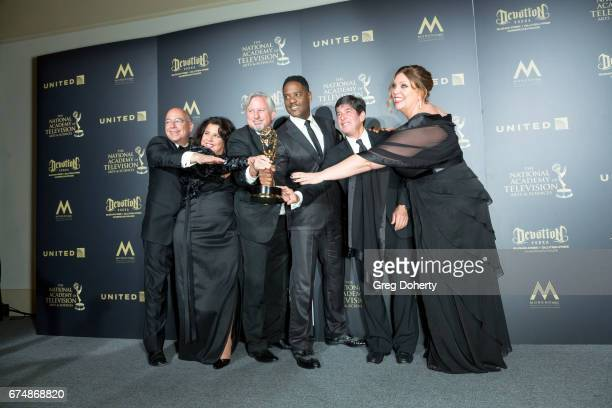 Executive Producers for 'Give' display their Emmy Award at the 44th Annual Daytime Creative Arts Emmy Awards at Pasadena Civic Auditorium on April 28...