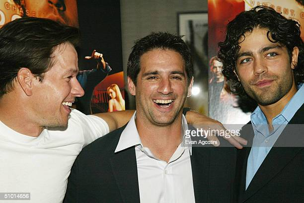 Executive producers Mark Wahlberg and Stephen Levinson pose with actor Adrian Grenier at the premiere screening of HBO's new series Entourage at the...