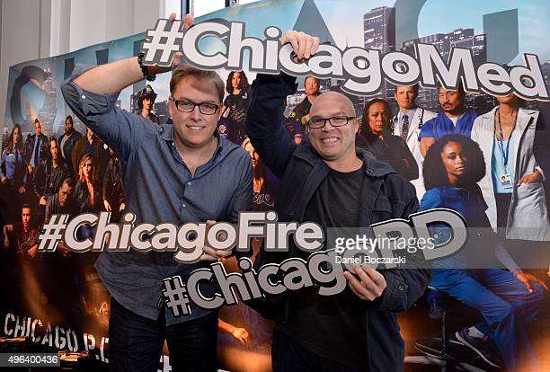 Executive Producers Michael Brandt and Derek Haas holding hashtags attend a press junket for NBC's 'Chicago Fire' 'Chicago PD' and 'Chicago Med' at...