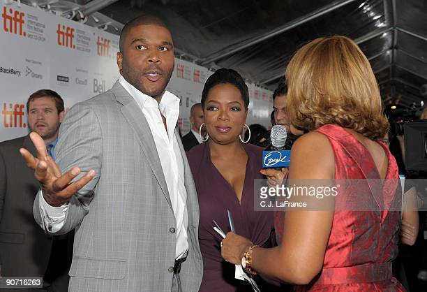 Executive producers Tyler Perry and Oprah Winfrey are interviewed as they arrive at the 'Precious Based on the Novel 'Push' by Sapphire' screening...