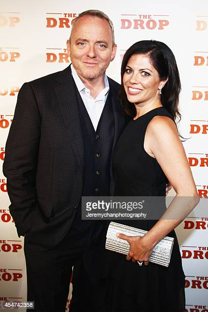 Executive Producer/screenwriter Dennis Lehane and his wife Angela Bernardo pose for a portrait at 'The Drop' after party during the 2014 Toronto...
