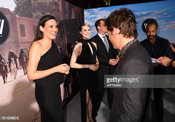 Executive producer/writer Lisa Joy actors Evan Rachel Wood and James Marsden attend the premiere of HBO's Westworld at TCL Chinese Theatre on...