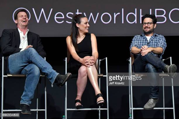 Executive producer/writer/director Jonathan Nolan executive producer/writer Lisa Joy and executive producer JJ Abrams speak onstage during HBO's...