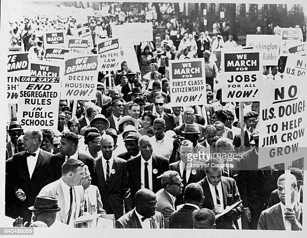 Executive secretary of the NAACP Roy Wilkins stands on The Mall with some of the 250000 participants heading for the Lincoln Memorial during the...