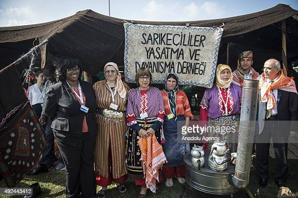 Executive Secretary of the United Nations Convention to Combat Desertification Monique Barbut visits a food tent as she wears traditional clothes...