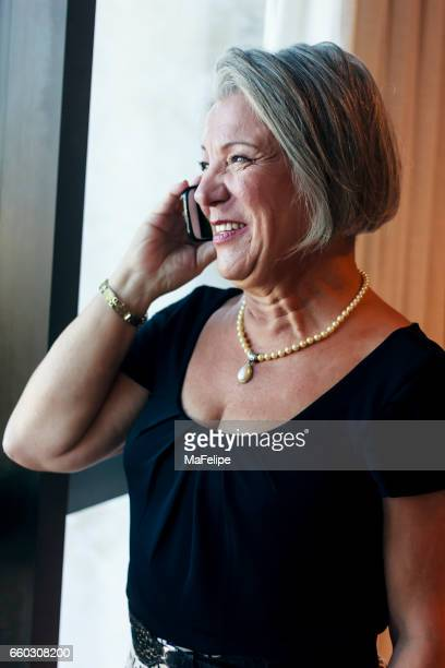 Executive senior woman talking on cell phone