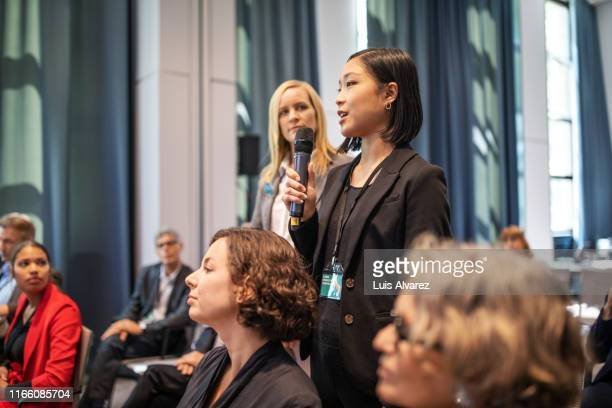 executive speaking during q and a session at seminar - launch event stock-fotos und bilder