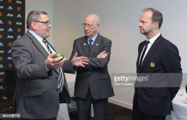 Executive Vice Chairman Ed Woodward and Sir Bobby Charlton of Manchester United talk with Lou McGrath OBE Chief Executive of Find A Better Way a...