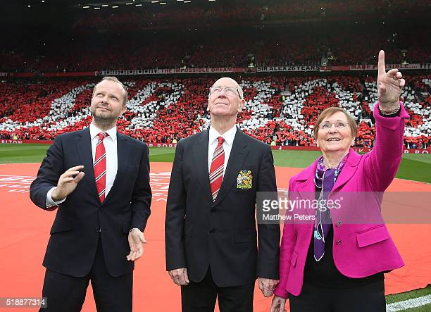Executive Vice Chairman Ed Woodward Sir Bobby Charlton of Manchester United and Lady Norma Charlton attend the unveiling of a stand renamed in Sir...