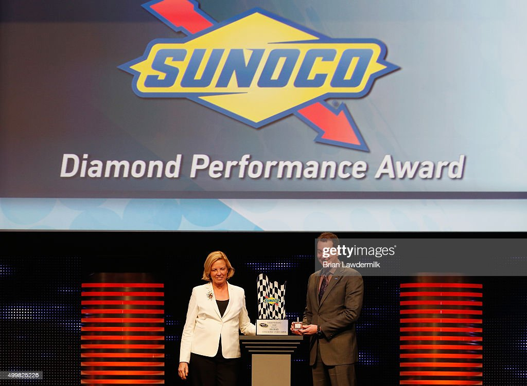 Executive Vice President and Chief Marketing Officer of Sunoco Cynthia Archer presents NASCAR Sprint Cup Series champion Kyle Busch with the Sunoco Diamond Performance Award during the 2015 NASCAR NMPA Myers Brothers Awards Luncheon at Encore Las Vegas on December 3, 2015 in Las Vegas, Nevada.
