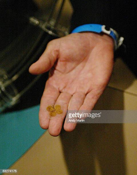 Executive Vice President and General Manager Craig Patrick of the Pittsburgh Penguins displays a four leaf clover he brought to the NHL draft lottery...
