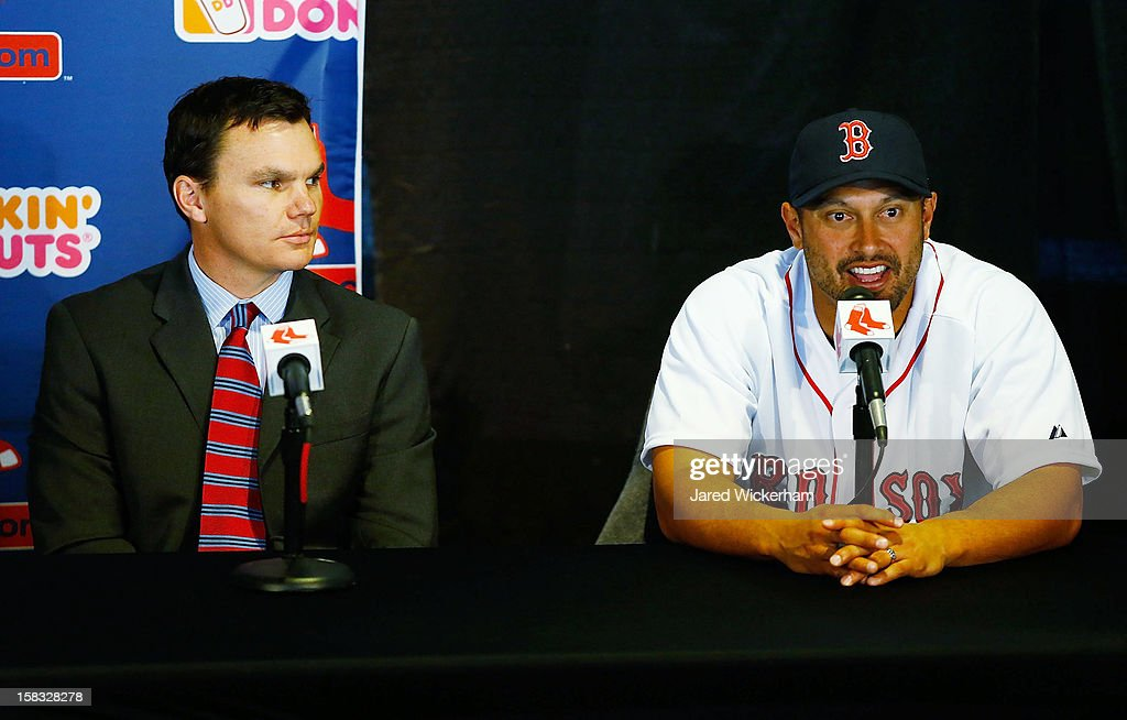 Executive Vice President and General Manager of the Boston Red Sox Ben Cherington (L) and Shane Victorino speak during a press conference after signing him to a three-year contract, on December 13, 2012 at Fenway Park in Boston, Massachusetts.