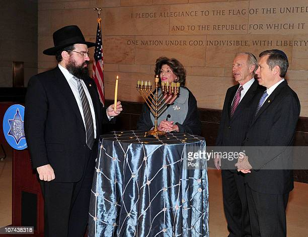Executive Vice President of American Friends of Lubavitch Rabbi Levi Shemtov prepares to light a Hanukkah Menorah in the atrium of the United States...