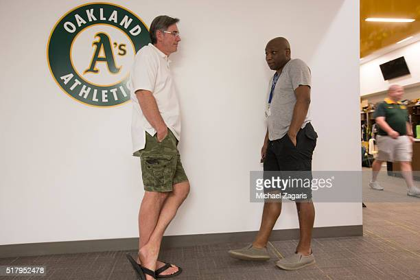 Executive Vice President of Baseball Operations Billy Beane of the Oakland Athletics talks with Howard Bryant in the clubhouse prior to a spring...