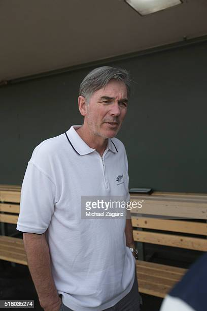 Executive Vice President of Baseball Operations Billy Beane of the Oakland Athletics stands in the dugout prior to a spring training game against the...