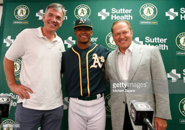 Executive Vice President of Baseball Operations Billy Beane of the Oakland Athletics first round draft pick Kyler Murray and Agent Scott Boras stand...