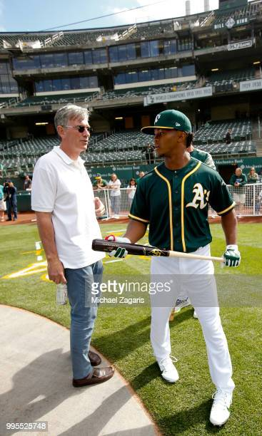 Executive Vice President of Baseball Operations Billy Beane of the Oakland Athletics talks with first round draft pick Kyler Murray on the field...