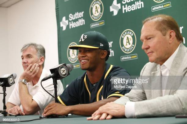 Executive Vice President of Baseball Operations Billy Beane of the Oakland Athletics first round draft pick Kyler Murray and Agent Scott Boras talk...