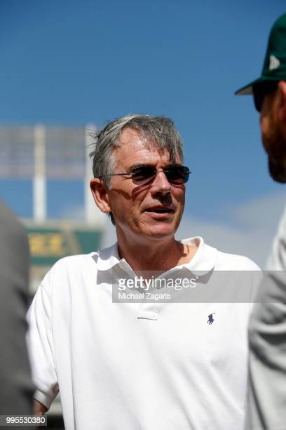 Executive Vice President of Baseball Operations Billy Beane of the Oakland Athletics stands on the field after first round draft pick Kyler Murray...