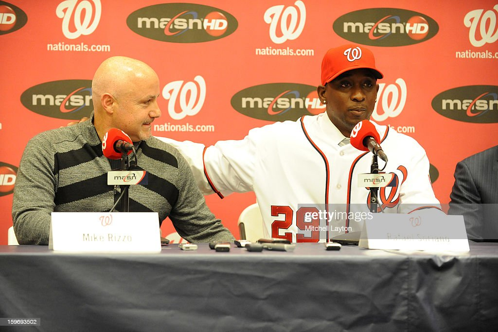 Executive Vice President of baseball operations Mike Rizzo and Rafael Soriano of the Washington Nationals during his introduction press conference on January 17, 2013 at Nationals Park in Washington, DC.