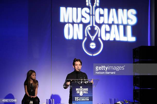 Executive Vice President Of Republic Records, Charlie Walk and his daughter onstage at Musicians On Call Celebrates Its 15th Anniversary Honoring...
