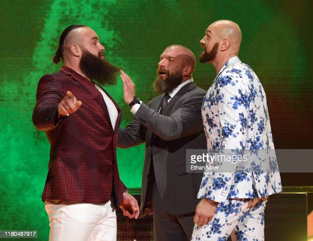 """Executive Vice President of Talent, Live Events and Creative Paul """"Triple H"""" Levesque gets between WWE wrestler Braun Strowman and heavyweight boxer..."""