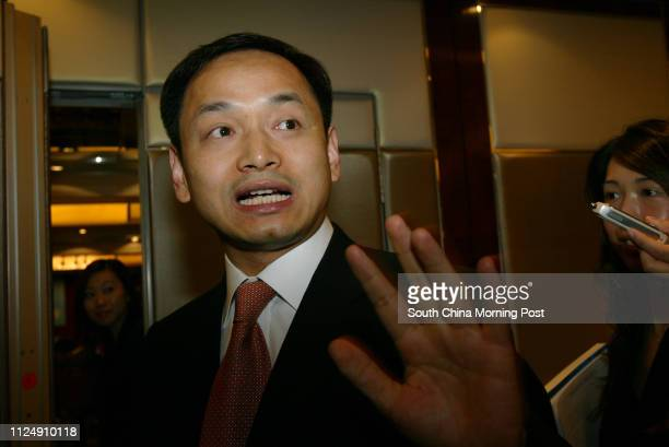 Executive vicepresident of China Power International Development Limited Hu Jiandong speaks to media during their annuel general meeting at...