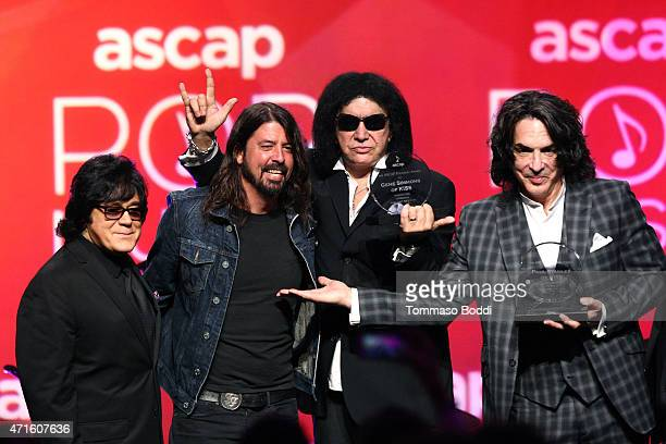 Executive VP of creative services John Titta and musician Dave Grohl honor musicians Gene Simmons and Paul Stanley with the ASCAP Founders Award on...