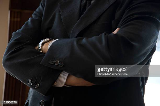 Executive with arms folded, cropped
