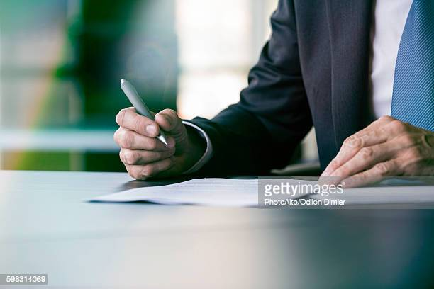 Executive writing letter by hand