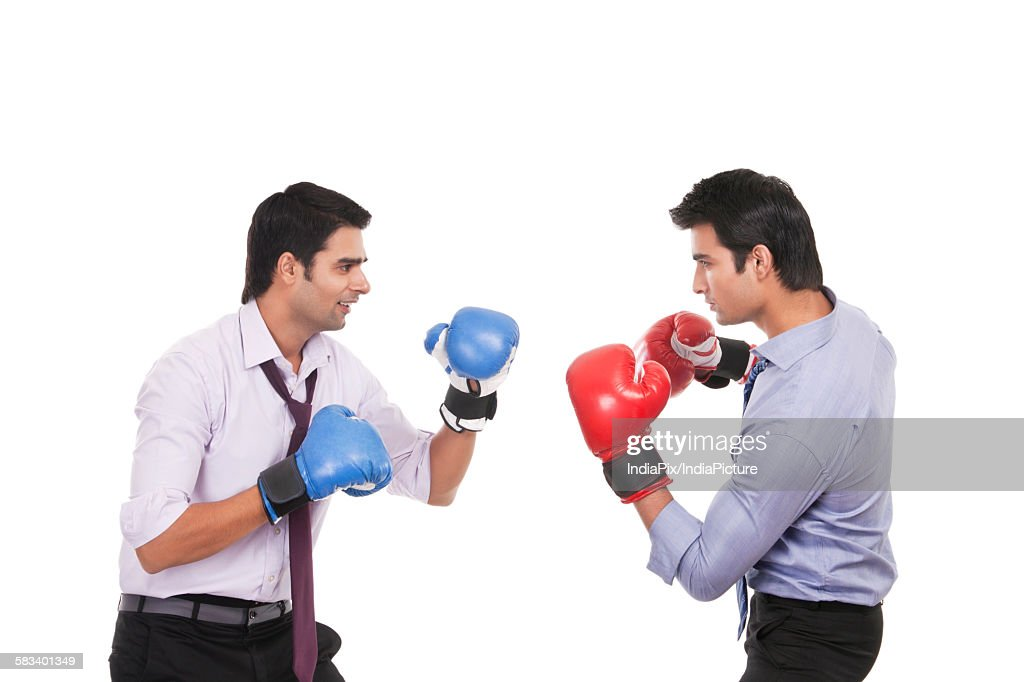 Executives boxing with each other : Stock Photo