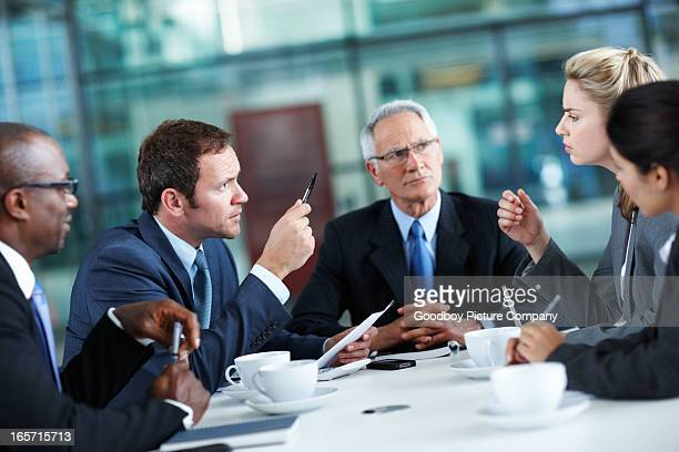 Executives discussing during meeting