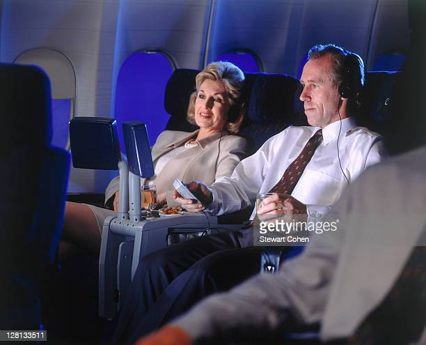 Executives enjoying in-flight video monitors