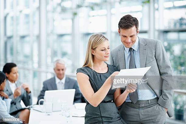 Executives going through a document with team in meeting